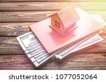 house  book  dollars on a... | Shutterstock . vector #1077052064