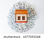 investment. model house on top... | Shutterstock . vector #1077055268