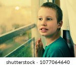 cute 10 year old autistic boy... | Shutterstock . vector #1077064640