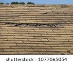 old damaged brown asphalt... | Shutterstock . vector #1077065054