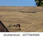 old damaged brown asphalt... | Shutterstock . vector #1077065060