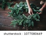 Woman making christmas wreath...