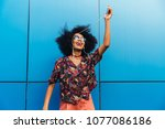 dancing attractive afro... | Shutterstock . vector #1077086186