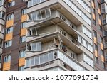 Small photo of Obninsk, Russia - April 22, 2018: Damage to loggias on a 20-storey house as a result of a strong hurricane wind. Workers dismantle damaged structures