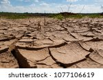 drought. the land dried up.... | Shutterstock . vector #1077106619