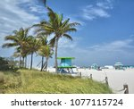palm trees on the beach in... | Shutterstock . vector #1077115724