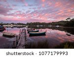 dawn at strahan harbour ... | Shutterstock . vector #1077179993