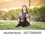 cheerful cute little girl... | Shutterstock . vector #1077180650