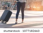 backside of beautiful traveler... | Shutterstock . vector #1077182663