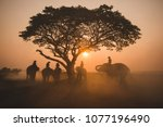 silhouette mahout ride on... | Shutterstock . vector #1077196490