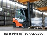 working forklift in warehouse.... | Shutterstock . vector #1077202880