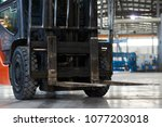 working forklift in warehouse.... | Shutterstock . vector #1077203018