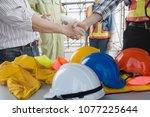 engineer group asia handshake... | Shutterstock . vector #1077225644