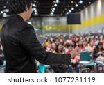 rear view of business people... | Shutterstock . vector #1077231119