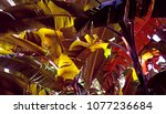 Small photo of Beautiful red and purple Abyssinian Banana leaves shot from below with sunlit leaves