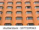 the windows of the hotel are... | Shutterstock . vector #1077239363