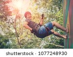 asian younger man hanging on...   Shutterstock . vector #1077248930