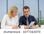 serious man and woman working... | Shutterstock . vector #1077262070