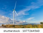 white wind turbine for... | Shutterstock . vector #1077264560