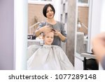 professional female hairdresser ... | Shutterstock . vector #1077289148