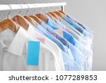 rack with clean clothes on... | Shutterstock . vector #1077289853