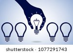 hand holding glowing lamp... | Shutterstock .eps vector #1077291743