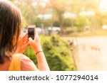 young asian woman photographer... | Shutterstock . vector #1077294014