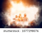 Group Of Firefighters Fighting...