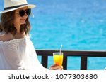 beautiful girl with white dress ... | Shutterstock . vector #1077303680