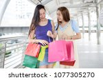 shopping is girls happiness. | Shutterstock . vector #1077305270