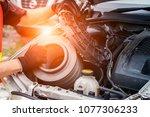 car mechanic working in repair... | Shutterstock . vector #1077306233