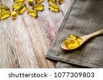 fish oil pills or omega 3 gel... | Shutterstock . vector #1077309803