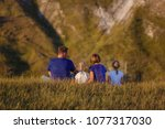 family in nature. happiness and ... | Shutterstock . vector #1077317030