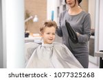 professional female hairdresser ... | Shutterstock . vector #1077325268