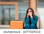 sad woman leaving with suitcase ... | Shutterstock . vector #1077329213