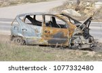 an abandoned  stolen burnt out... | Shutterstock . vector #1077332480