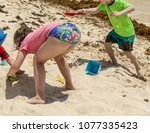 kids play with sand at a... | Shutterstock . vector #1077335423
