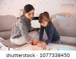 female psychologist working... | Shutterstock . vector #1077338450
