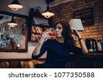 beautiful girl in drinks aperol ...   Shutterstock . vector #1077350588