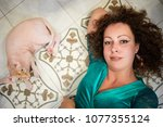 woman with curly hair and... | Shutterstock . vector #1077355124