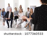 female business trainer giving... | Shutterstock . vector #1077360533