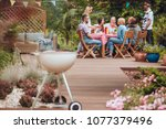 wooden patio in the garden with ... | Shutterstock . vector #1077379496
