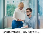 manager giving feedback to... | Shutterstock . vector #1077395213