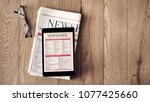 reading news on tablet and... | Shutterstock . vector #1077425660