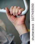 powerless man clutching a... | Shutterstock . vector #1077435050