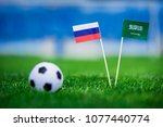 Small photo of National flag of Russia and Saudi Arabia on Football pitch. Football ball on green grass. First match of World cup in russia 2018