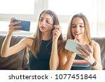 teenager girls best friends... | Shutterstock . vector #1077451844