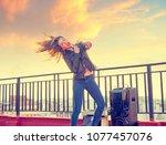 band girl singing karaoke... | Shutterstock . vector #1077457076