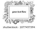 hand drawn doodle floral frame... | Shutterstock .eps vector #1077457394