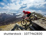 a man is riding enduro bicycle  ... | Shutterstock . vector #1077462830